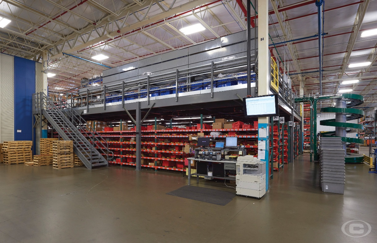 A parts inventory mezzanine with a gray staircase
